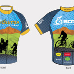 The 2014 Rev jersey features silouettes of a handcyclist and a two-wheeled cyclist with a green valley and a mountain range in the background
