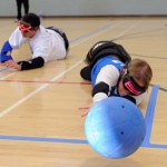 Goalball players diving on floor to make a save