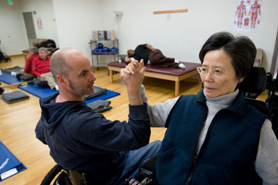 A BORP fitness instructor assists a class participant
