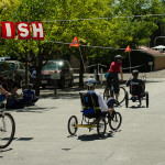 Cyclists cross the Finish Line at the 2014 Revolution Ride