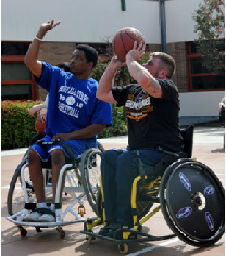A veteran receives instruction on wheelchair basketball