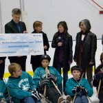 Kristi Yamaguchi presents a giant check to BORP