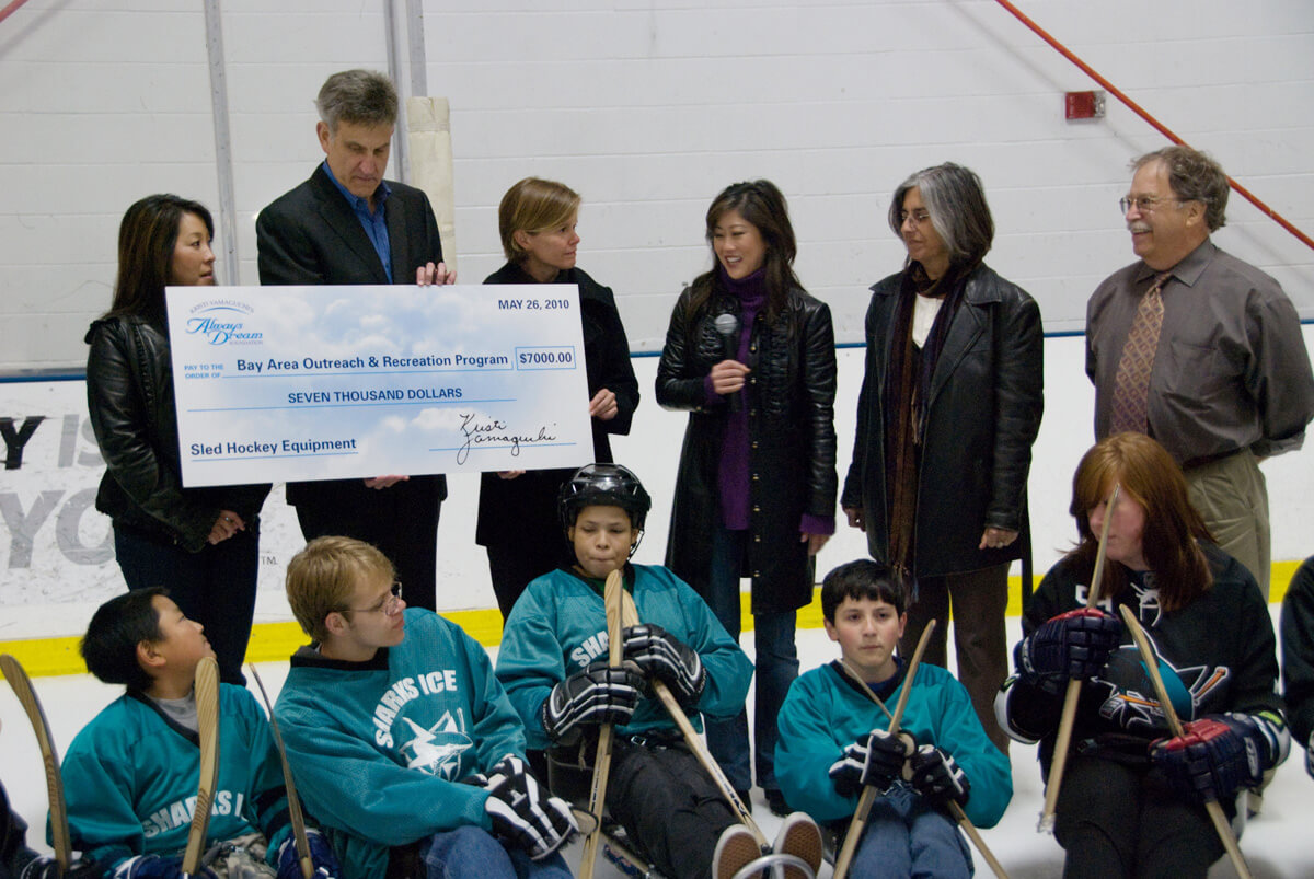 Kristi Yamaguchi presents a giant-sized check to BORP