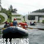 Adventures and Outings: picture of white water rafting trip, two rafts floating down a river from behind