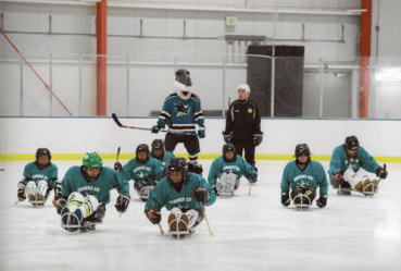 BORP youth hockey players on the ice with the San Jose Sharks mascot