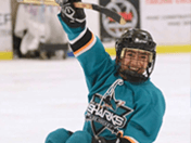 Sled hockey player celebrates on the ice