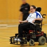 Talia speeds down the court during a power soccer game