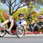 Dan & Danny ride a recumbent tandem cycle at the Rev