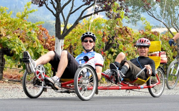 Dan & Danny ride a recumbent tandem cycle at the Rev