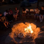 BORP Junior Adventurers sit aound a campfire