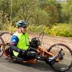 A handcyclist cruises past gorgeous scenery in Sonoma