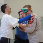 Three members of a goalball team congratulate each other after a game