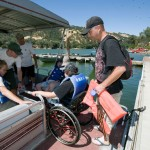 BORP Jr. Adventurer boards a boat on Lake Del Valle