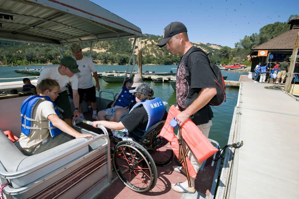 BORP Jr. Adventurer boards a boat on Lake Del Valle