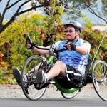 Big Sam rides a handcycle at the Rev