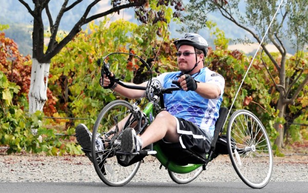 Big Sam rides a handcycle at the Rev