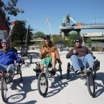Three Vets on recumbent bikes give the thumbs up at BORP Cycling Center