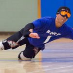 Roger Acuna dives to make a stop in a goalball game