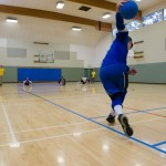 A view of a goalball player about to roll a shot down the length of the court