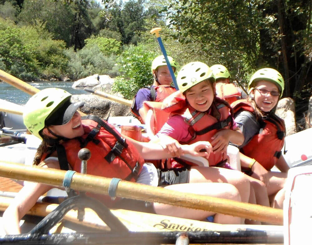 Junior Adventurers share a laugh in a whitewater raft