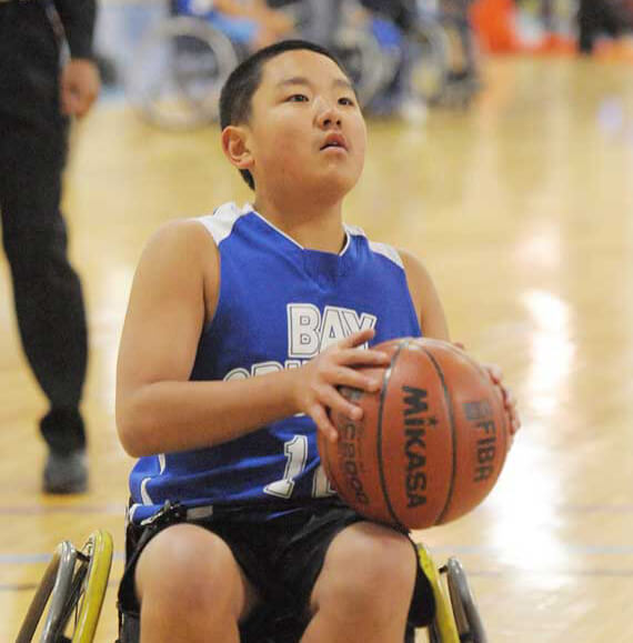 A young wheelchair basketball player