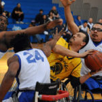 BORP defenders triple team an oppenent during a wheelchair basketball game