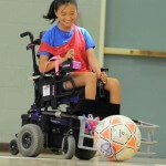 Ruby is all smiles while playing power soccer