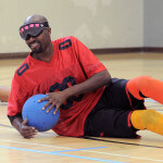 A BORP goalball player smiles after making a save