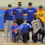 The 2013 Cal Goalball team poses in front of a net