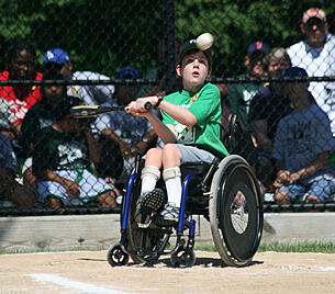 A Challenger baseball player gets ready to swing at a pitch