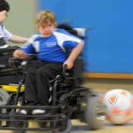 Cosmo is a blur during a power soccer game