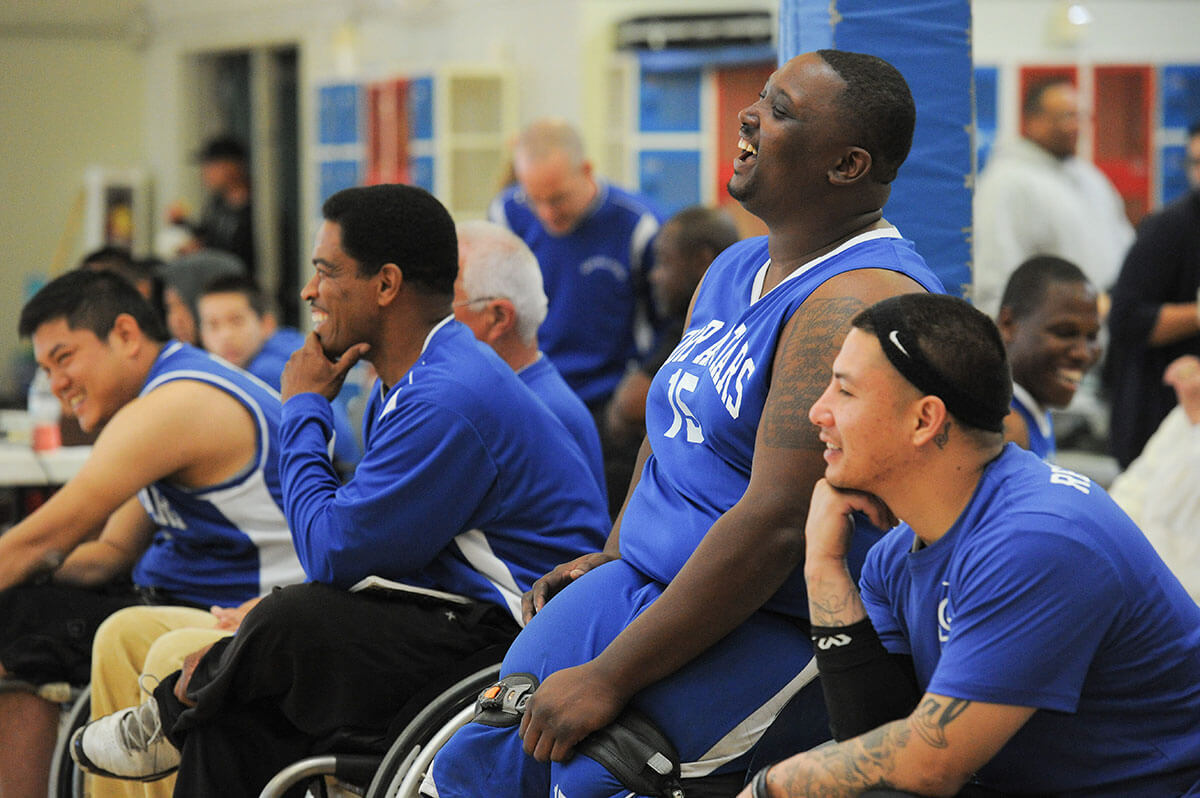 Members of the BORP All Stars share a laugh during the 2014 Hoops Classic