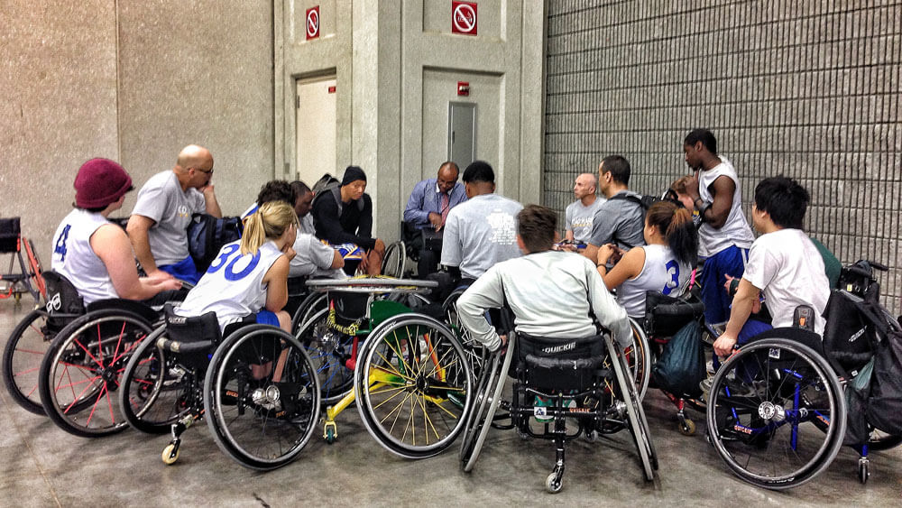 Members of the 2014 Golden State Road Warriros and BORP Jr. Road Warriors huddle together