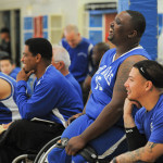 Members of the BORP All Stars team share a laugh on the sideline while watching a game