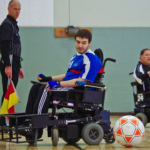 Power Soccer player kicks the ball