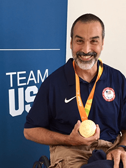Trooper Johnson, Assistant Coach for USA Women's Wheelchair Basketball, with Gold Medal in Rio