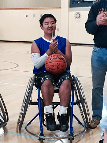 Matthew with basketball signed by the Warriors