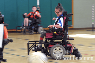 April playing power soccer