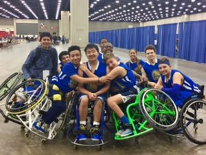 Group hug at the National Wheelchair Basketball Tournament