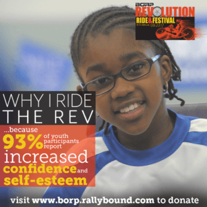 Image of young BORP Power Soccer Player smiling at the camera. Text over image: Why I ride the REV ...because 93% of youth participants report increased confidence and self-esteem