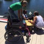 Transferring into the boat at BORP's adaptive dock