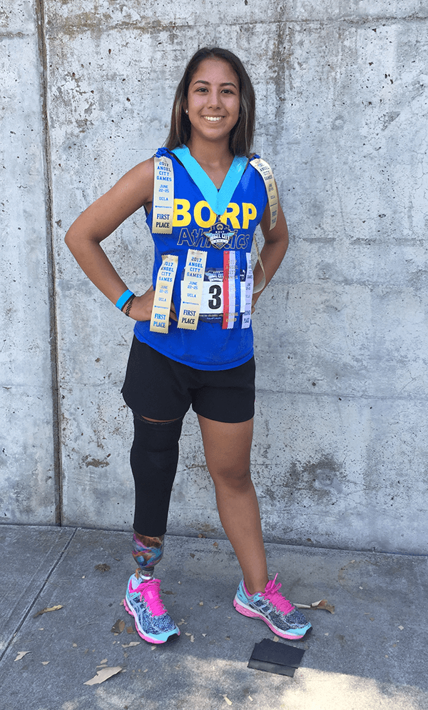 Ella, who owned track and field at the 2017 Angel City Games, poses with her many ribbons and medals