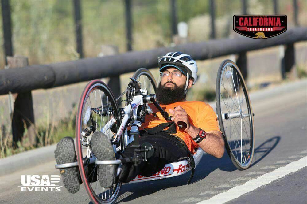 Abdullah focused on the road ahead rides his Top End hand cycle