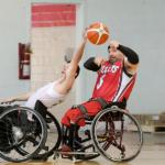 Player attempts to block a pass, wheelchair basketball