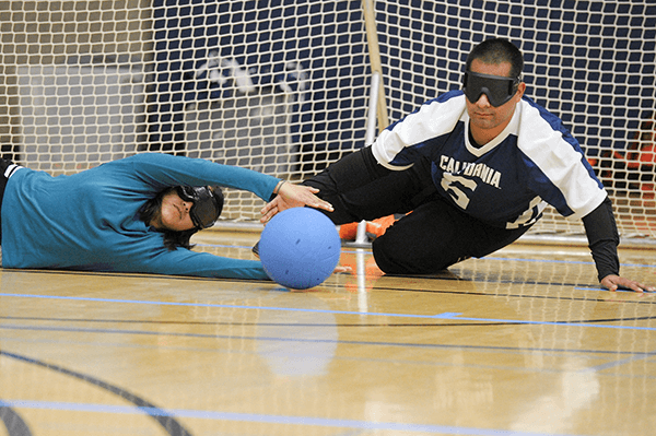 Goalball player defends the goal
