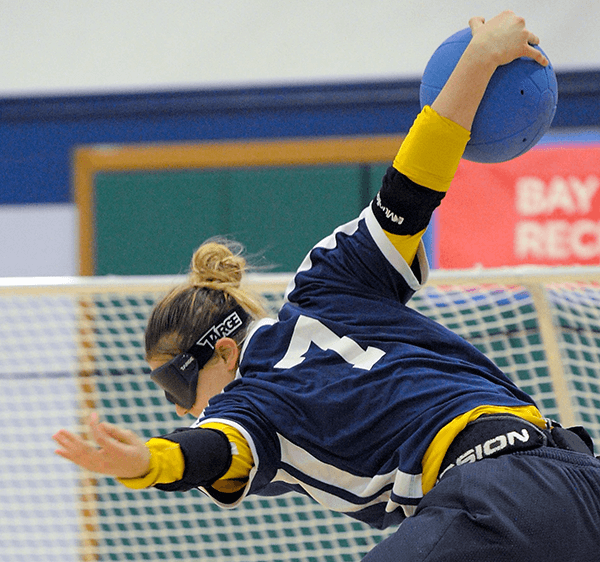 Cal Goalball Player throws the ball at the BORP Goalball Invitational