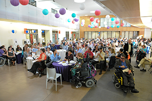 BORP Spring Awards event: large room at Ed Roberts Campus filled with people sitting at tables during the event