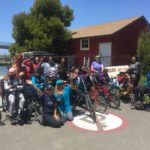 Group photo of the kids from Oakland's Cole School at the BORP Cycling center
