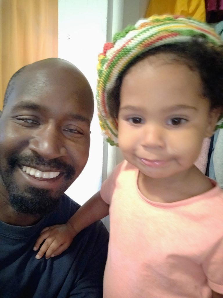 Photo of Brandon Young with his daughter